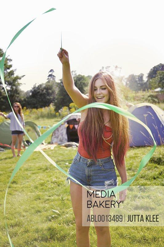 Teenage Girl Playing with Green Ribbon
