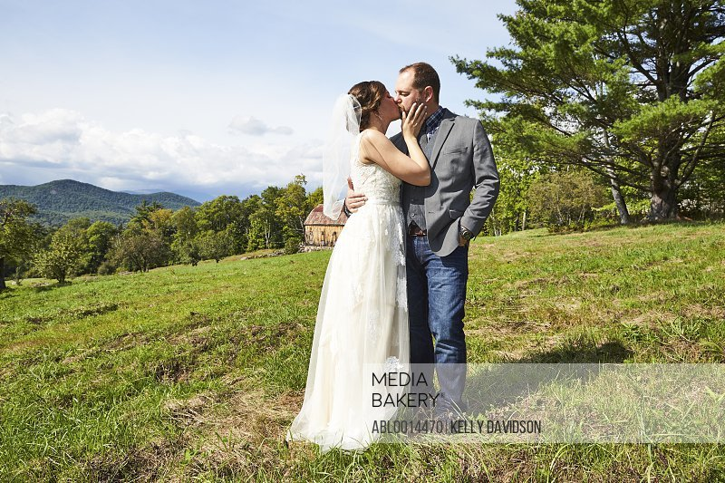 Bride and Groom Kissing in Countryside