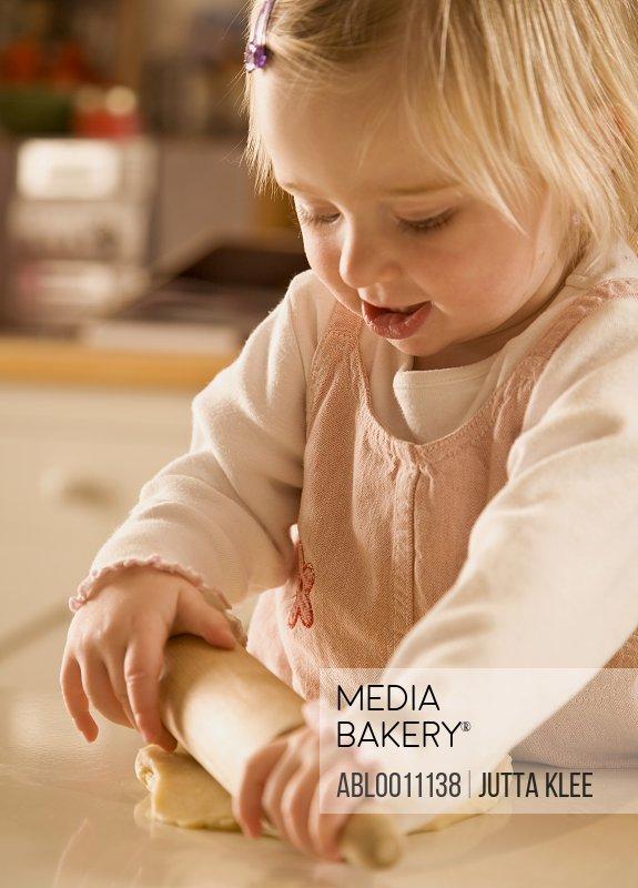 Young girl baking