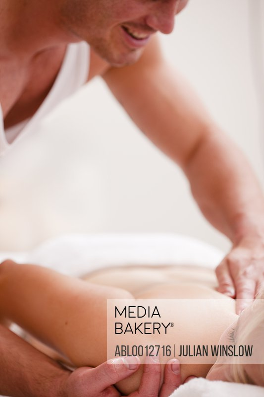 Masseur giving a woman a massage