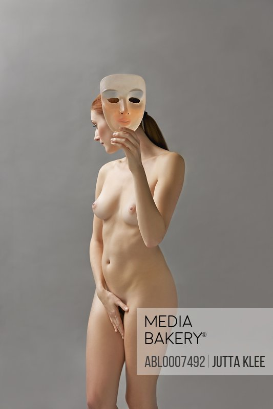 Nude Woman Holding Mask