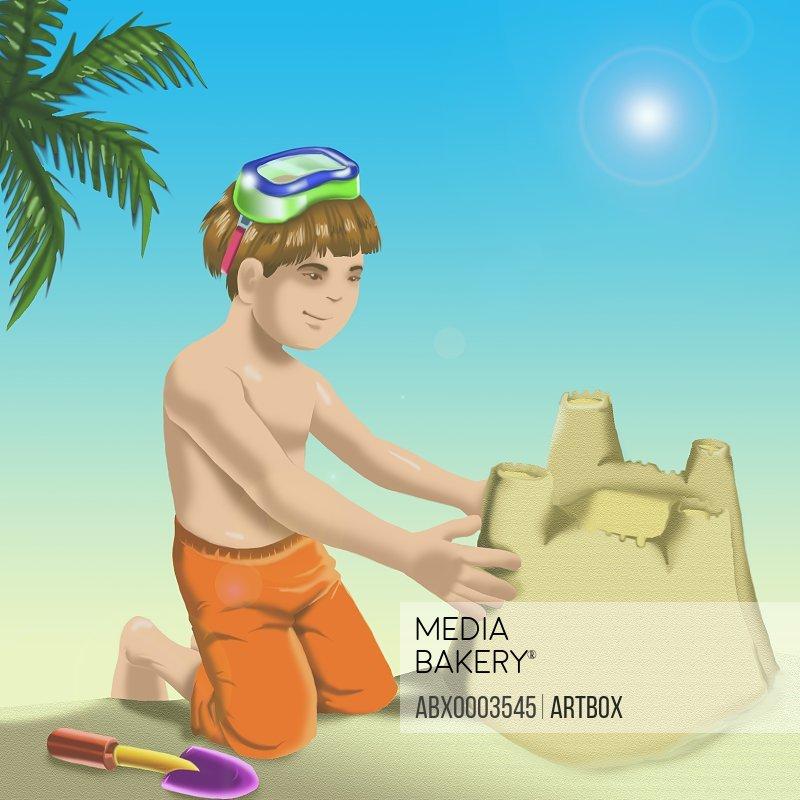 Boy making a sand castle on the beach