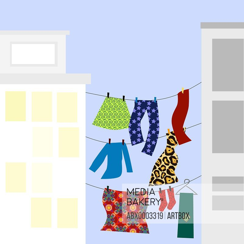 Clothes hanging on clotheslines between two buildings