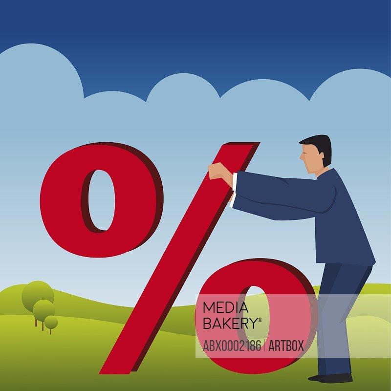 Businessman touching a percentage symbol