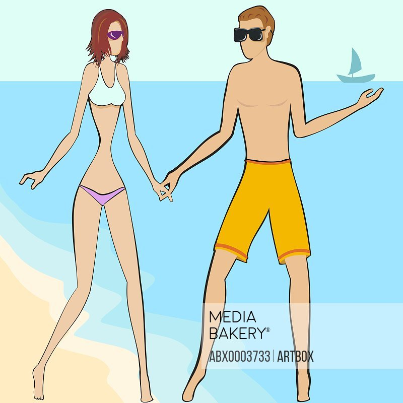 Young couple standing on the beach