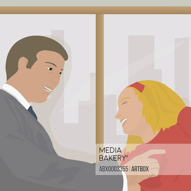 Businessman smiling with a businesswoman