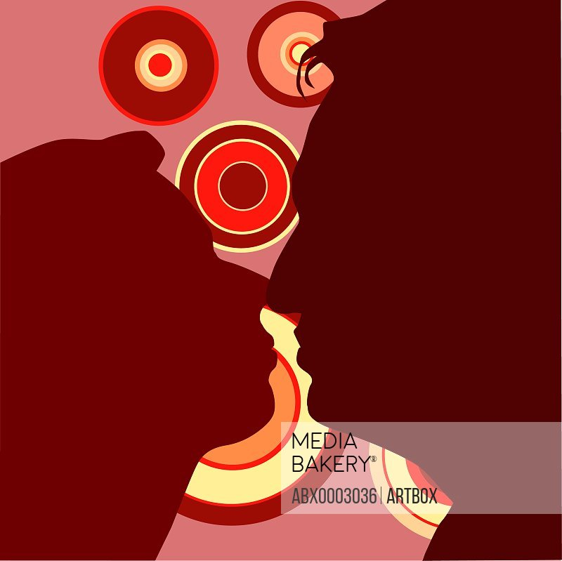 Silhouette of a man and a woman kissing