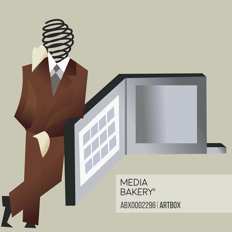 Businessman leaning against a presentation board