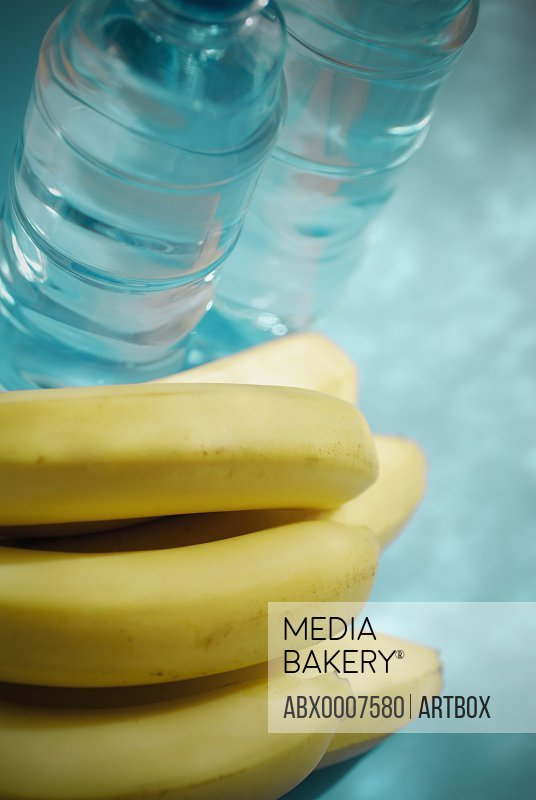 Close-up of bananas and two water bottles