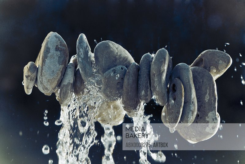 Water dripping from pebbles