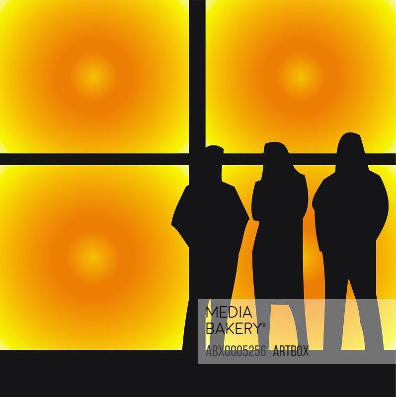 Three people standing in a nightclub