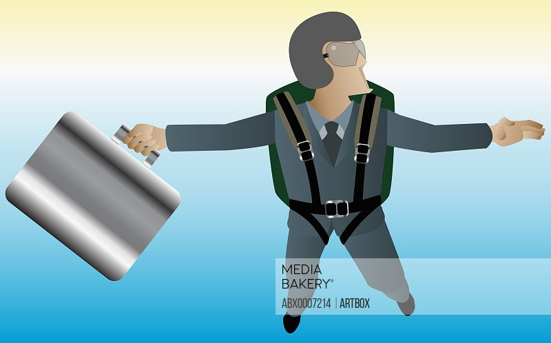 Businessman skydiving with a briefcase