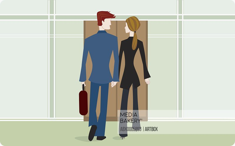 Businesspeople holding hands and walking