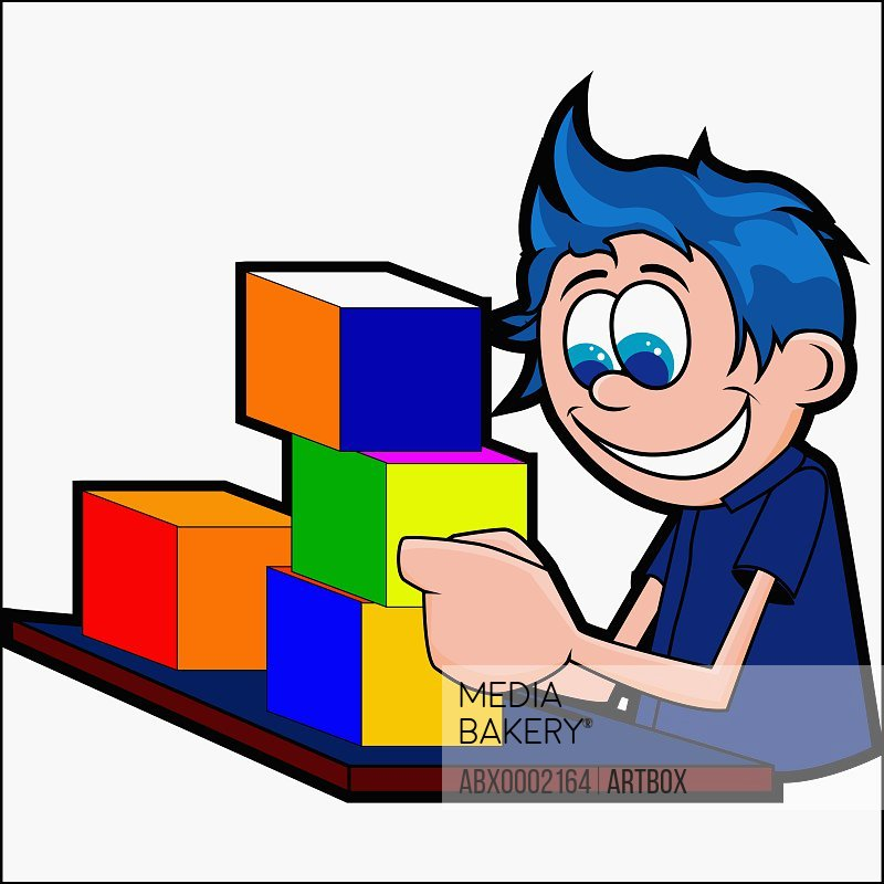 Boy playing with colored blocks