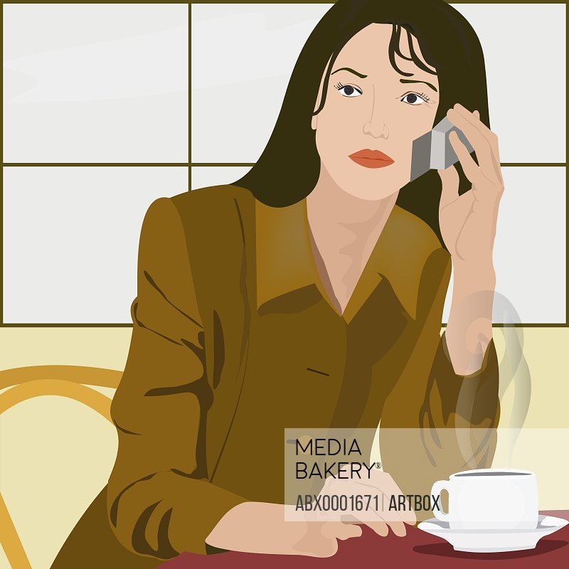 Woman talking on a mobile phone in a restaurant
