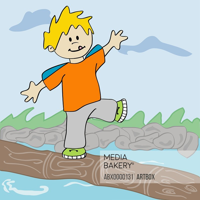 Boy standing on a log floating in water
