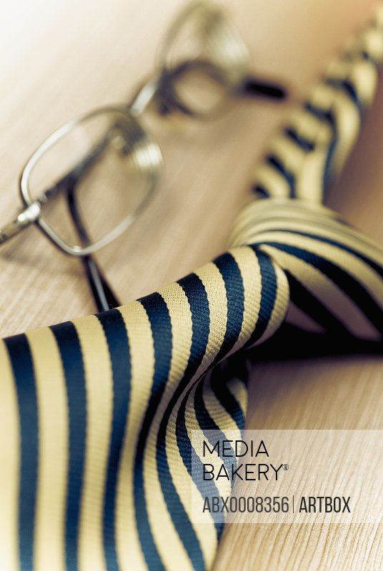 Close-up of eyeglasses with a tie