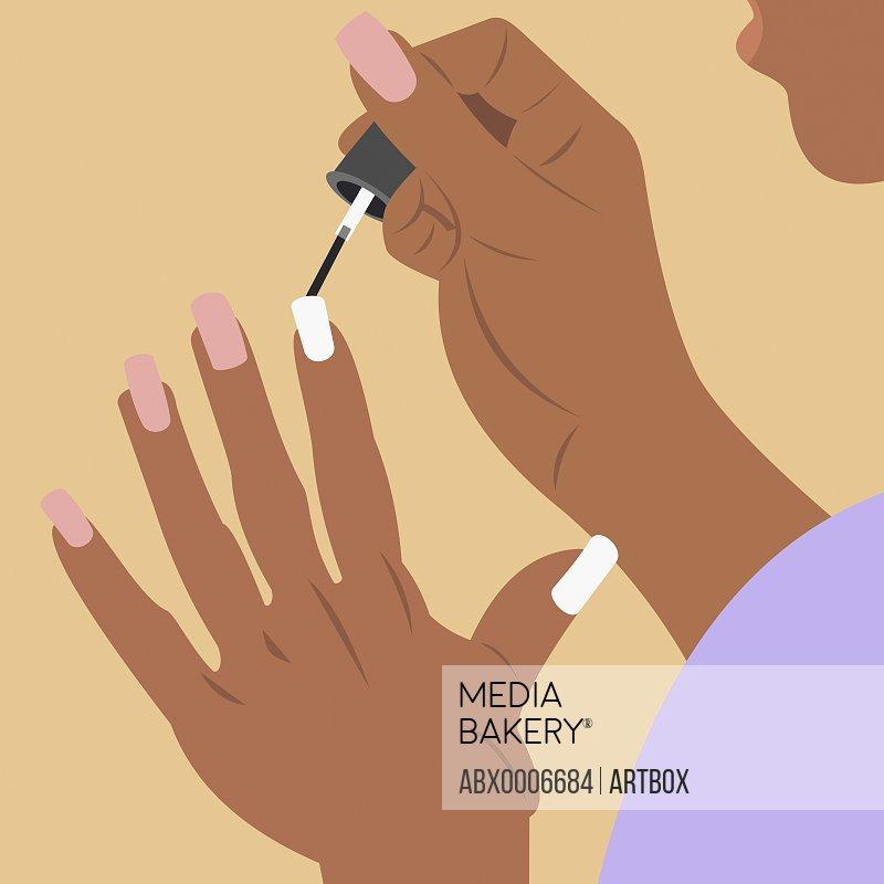 Woman applying nail polish on her fingernails
