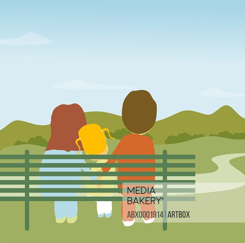 Parents and daughter sitting on a park bench