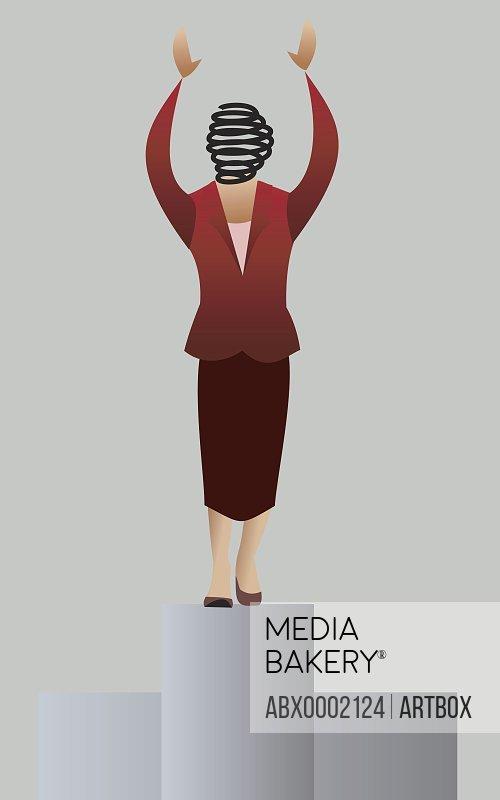 Businesswoman standing on a pedestal