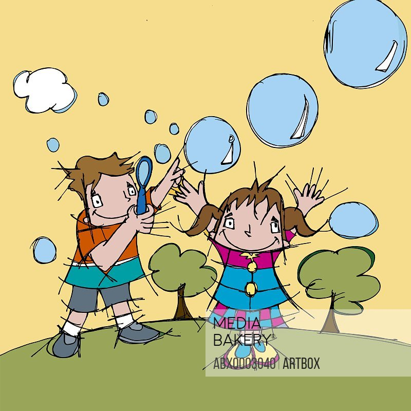 Boy and a girl blowing soap bubbles in the park