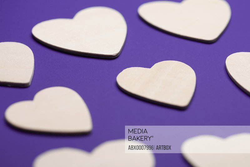 Close-up of heart shapes on a purple background