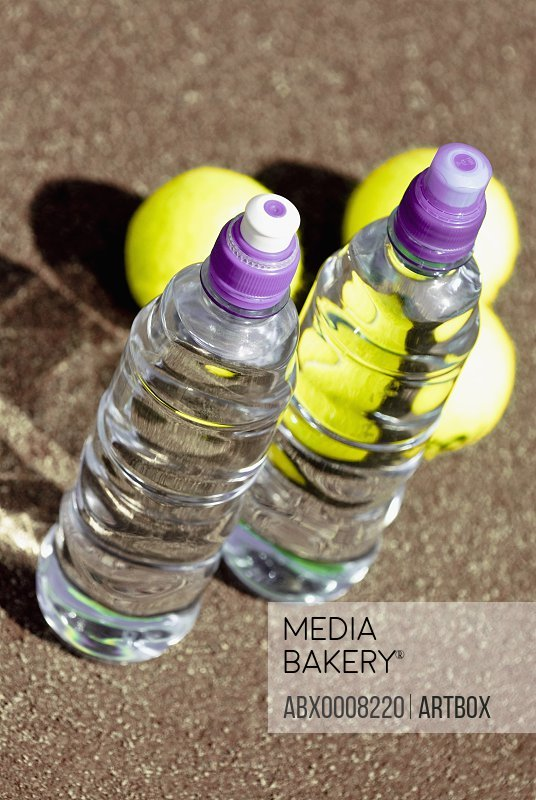 High angle view of two water bottles and three tennis balls