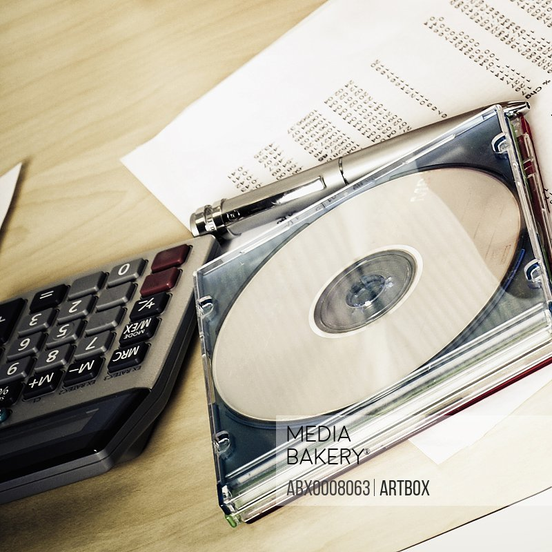 Close-up of a compact disk with a calculator
