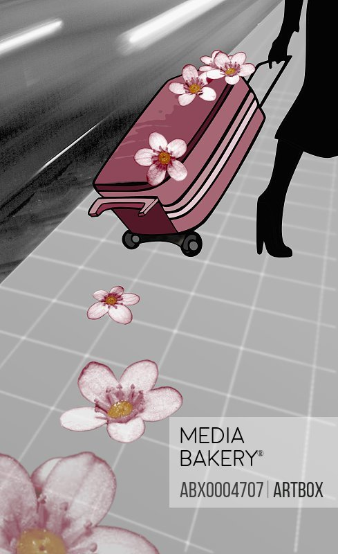Low section view of a woman pulling a suitcase