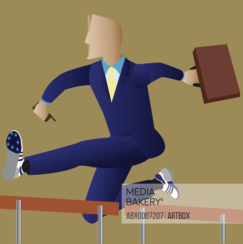 Businessman jumping over hurdles in a race