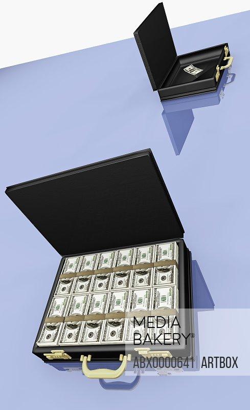 US dollar bills arranged in a briefcase