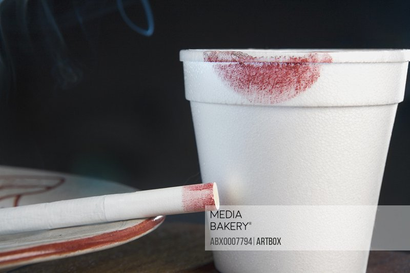 Close-up of a lipstick mark on a disposable cup