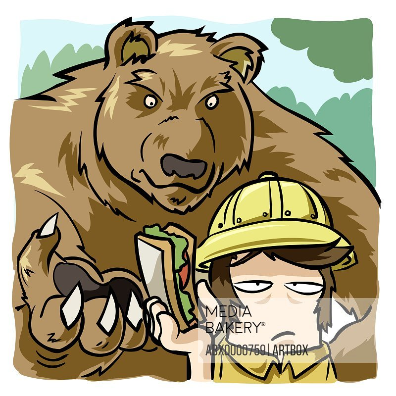 Close-up of a man offering a sandwich to a bear