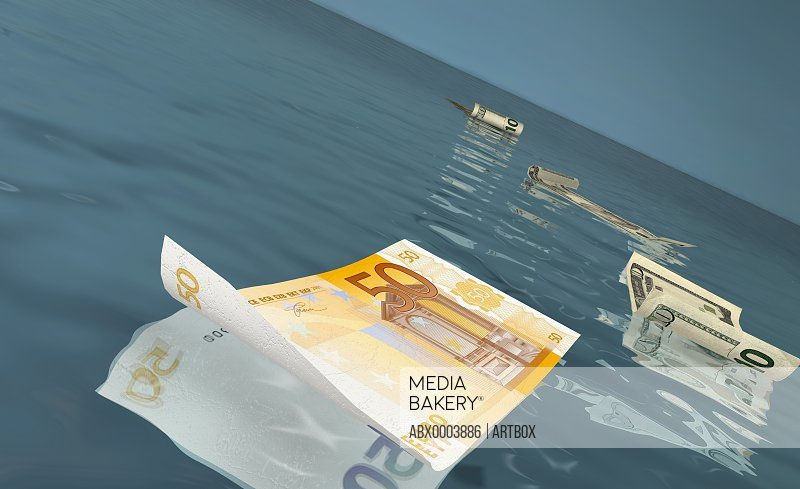 American and Euro bank notes floating on water