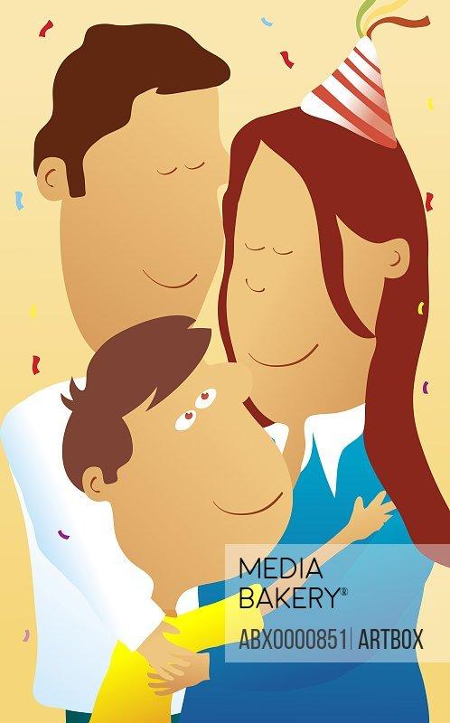 Boy hugging his parents at his birthday party