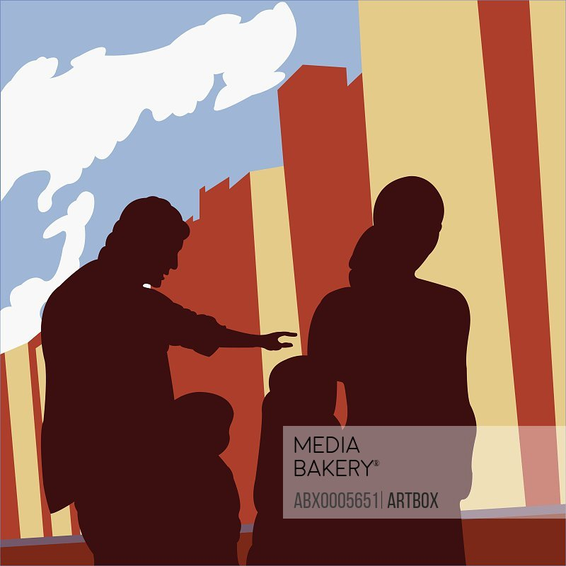 Silhouette of parents walking with their children