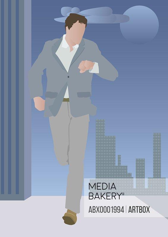 Businessman walking on the sidewalk