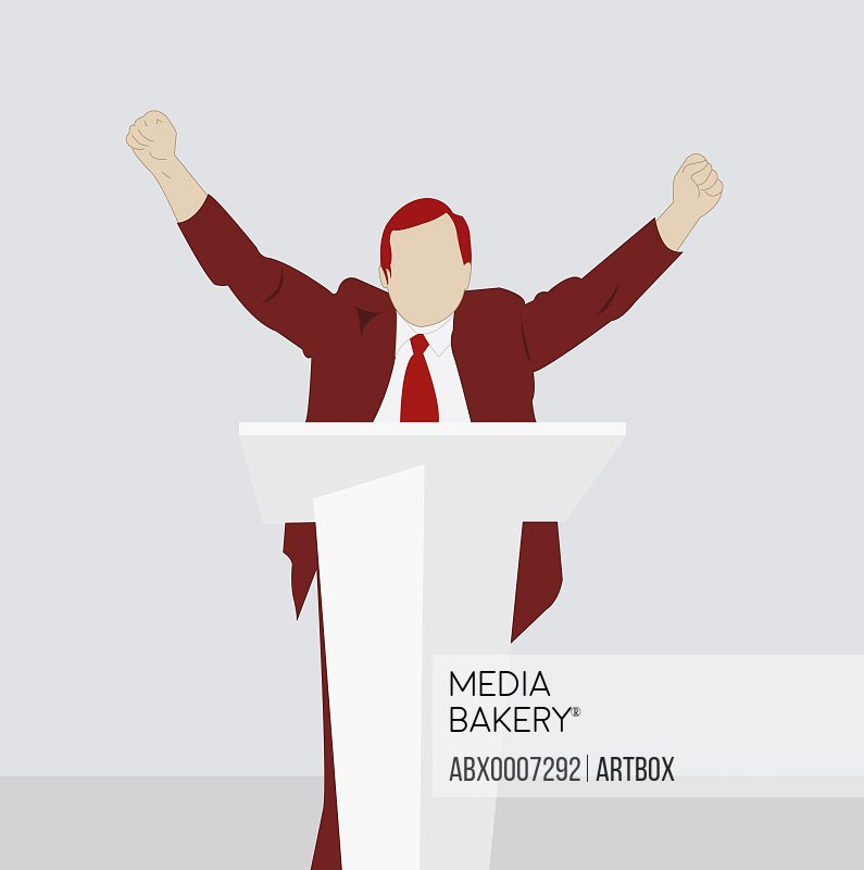 Businessman at a podium with arms raised