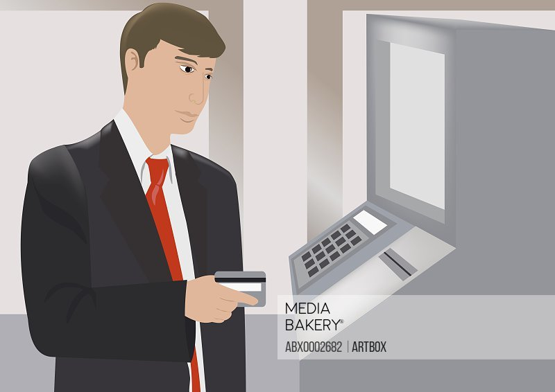 Close-up of a businessman placing cash card in an ATM machine