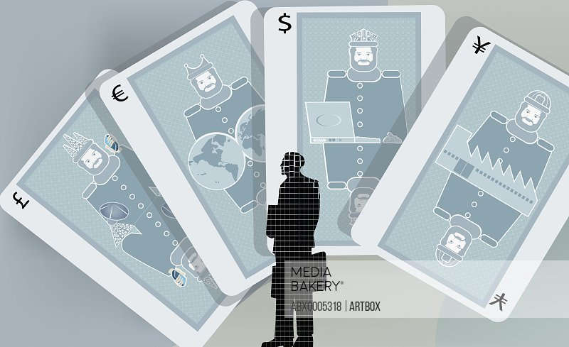 Businessman standing in front of cards with currency symbols