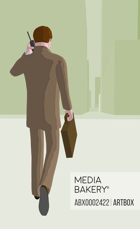 Rear view of a businessman talking on a cordless phone
