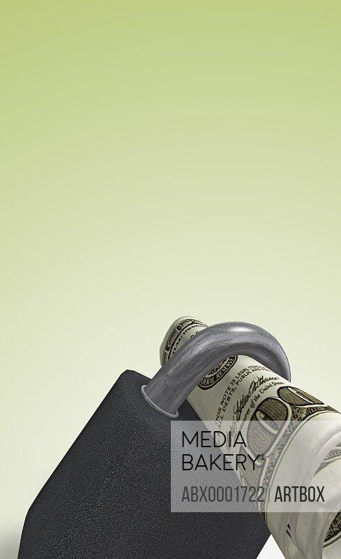 Rolled American dollar bill in a pad lock