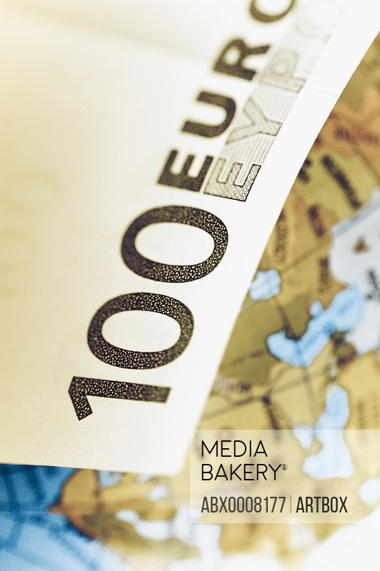 Close-up of a one hundred euro banknote with a globe