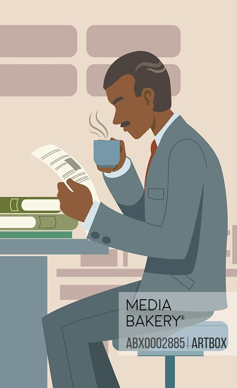 Man drinking a cup of coffee and reading a book