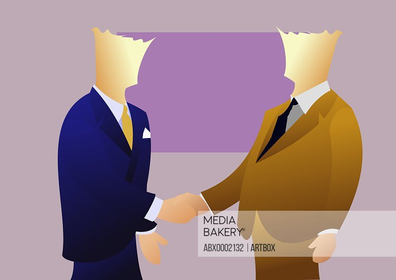 Side profile of two businessmen shaking hands