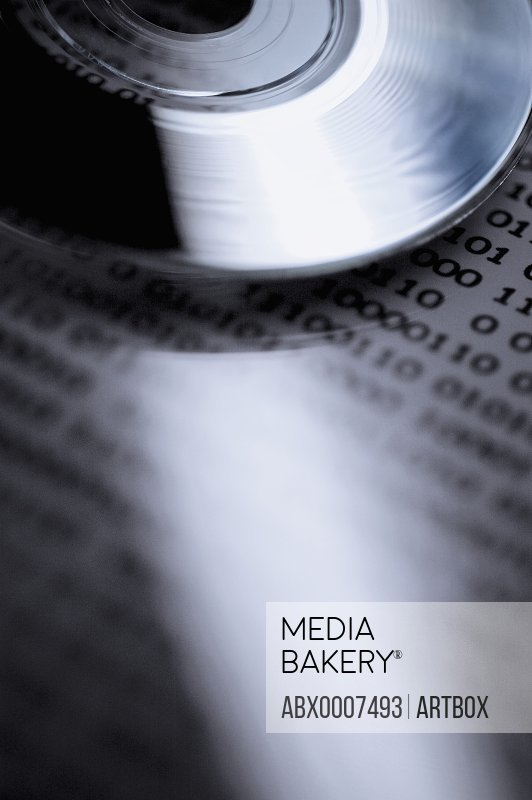 Close-up of a compact disc on a document