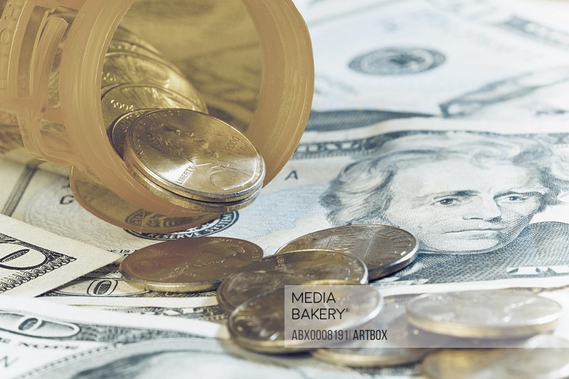 Close-up of coins and paper currencies