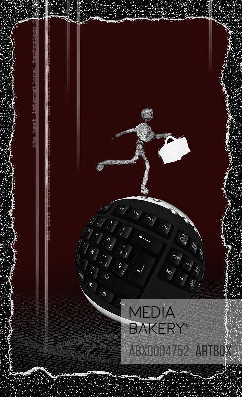 Figurine of a man walking on a computer keyboard