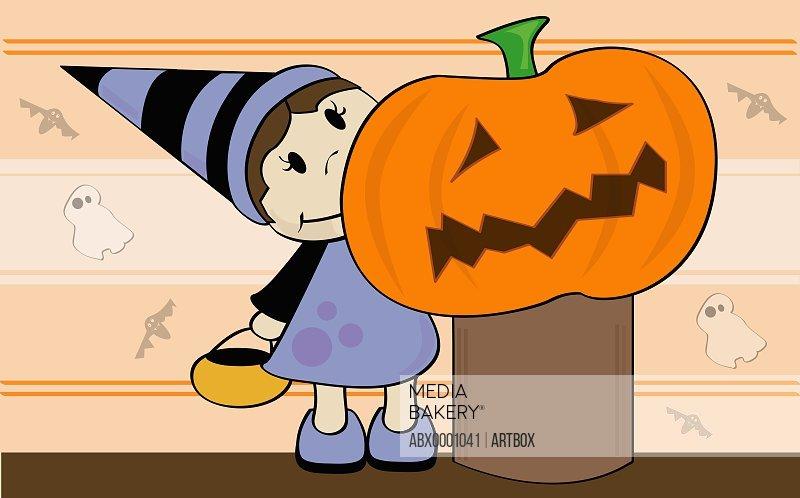 Girls standing near a Halloween pumpkin