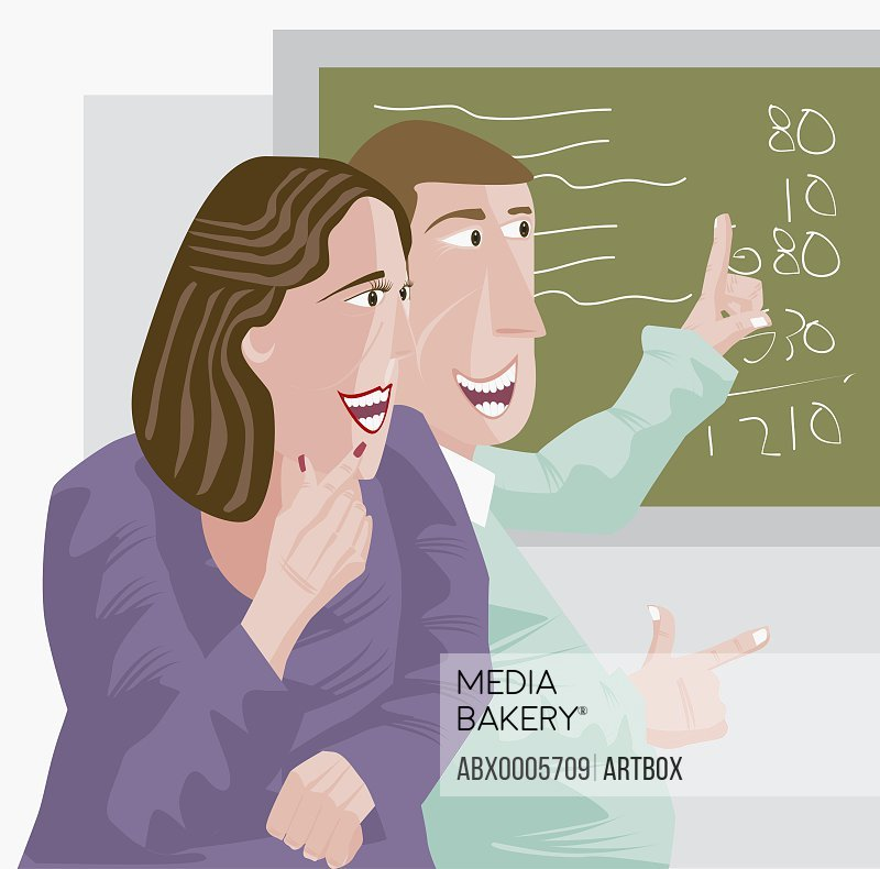 Young man pointing at a blackboard and looking at a young woman